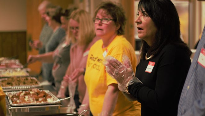 Volunteers help serve meals at Emanuel Lutheran Church on Thursday afternoon. As of 3:00 p.m. that afternoon, over 500 meals were served.