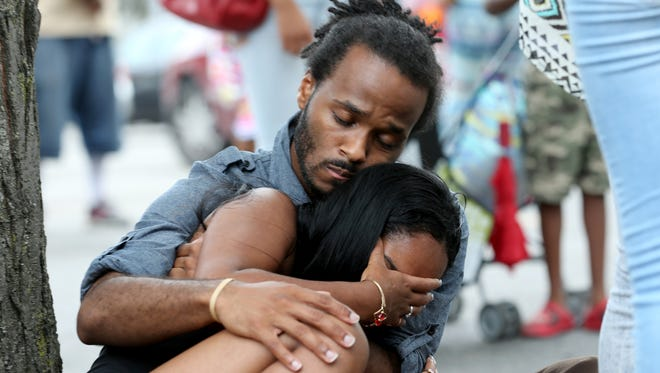 Finesse Dillard is comforted Thursday by her uncle Anderson Allen.