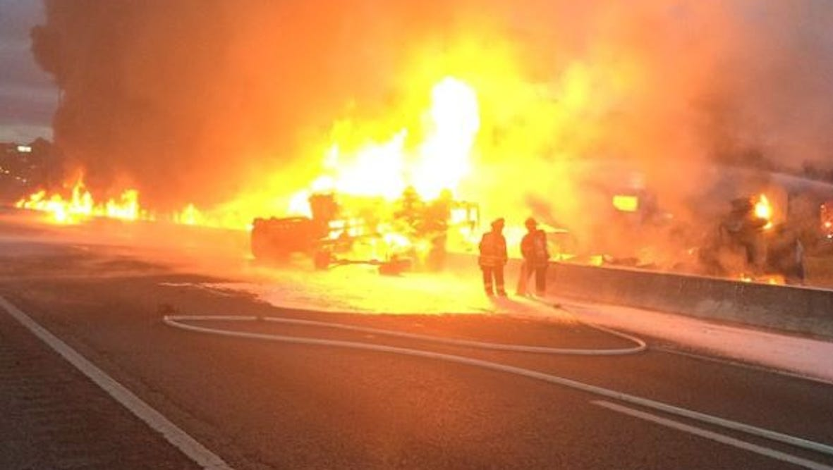 A fire engulfs vehicles along Interstate 26 north of