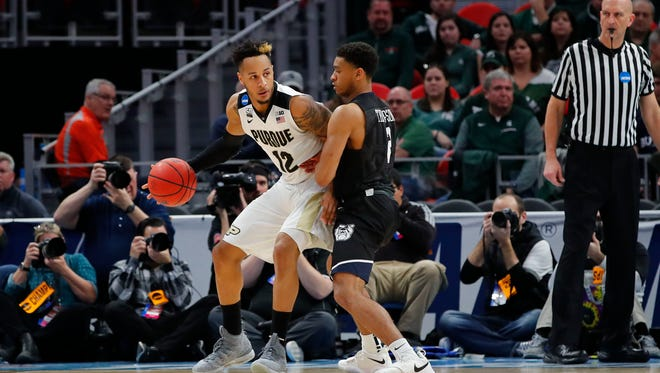Mar 18, 2018; Detroit, MI, USA; Purdue Boilermakers forward Vincent Edwards (12) looks to move around Butler Bulldogs guard Aaron Thompson (2) in the first half in the second round of the 2018 NCAA Tournament at Little Caesars Arena. Mandatory Credit: Rick Osentoski-USA TODAY Sports