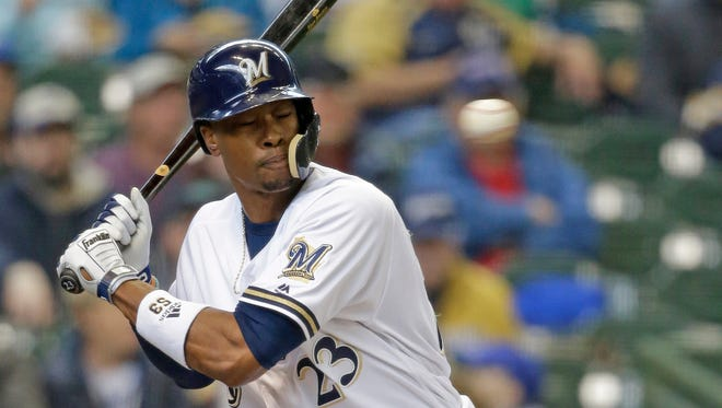 Brewers centerfielder Keon Broxton gets hit in the helmet by a pitch from Rockies starter Antonio Senzatela in the second inning Thursday at Miller Park.