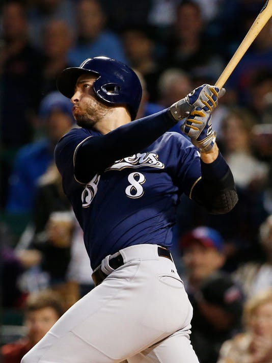 Milwaukee Brewers' Ryan Braun hits a two-run home run against the Chicago Cubs during the first inning of a baseball game Friday, Sept. 8, 2017, in Chicago. (AP Photo/Nam Y. Huh)