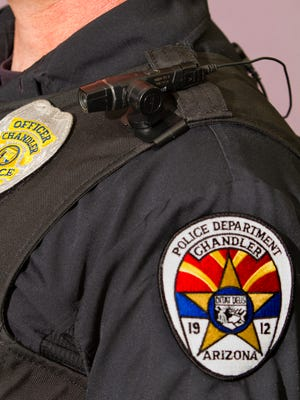 A Chandler police officer's protective vest, body camera and badge.