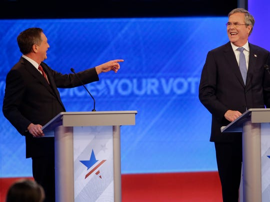 Republican presidential candidate, Ohio Gov. John Kasich points toward Republican presidential candidate, former Florida Gov. Jeb Bush during a Republican presidential primary debate hosted by ABC News at the St. Anselm College  Saturday, Feb. 6, 2016, in Manchester, N.H.