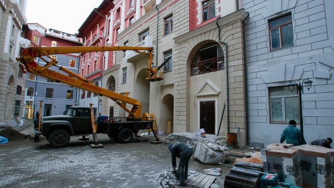 Workers put the finishing touch on a hotel or the Sochi 2014 Winter Olympics.
