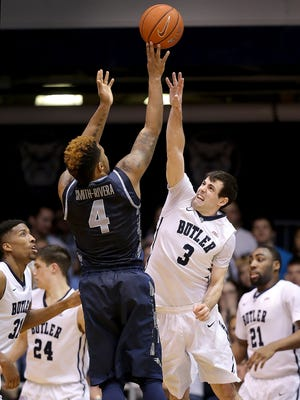 Butler Bulldogs guard Alex Barlow (3) attempts to block the shot by Georgetown Hoyas guard D'Vauntes Smith-Rivera (4) in the first half at Hinkle Fieldhouse.