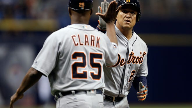 Detroit Tigers' Miguel Cabrera high fives third base coach Dave Clark (25) after hitting a home run off Tampa Bay Rays starting pitcher Matt Andriese during the first inning of a baseball game Tuesday in St. Petersburg, Fla.