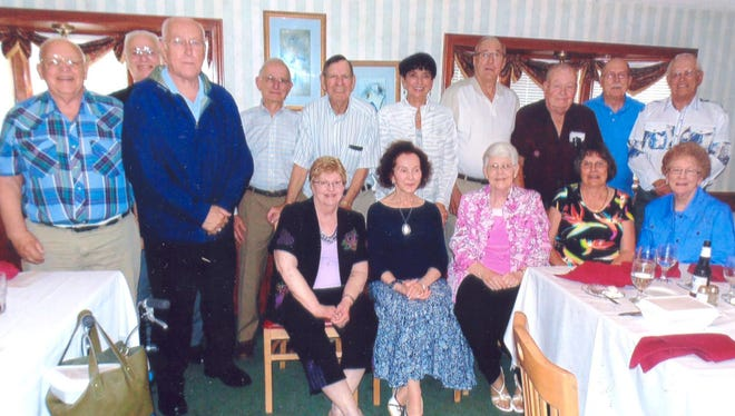 The Nekoosa High School class of 1956 met recently at Lake Aire Supper Club. Pictured are Jim Kutella, back row from left, Richard Wilhorn, Dave Heminger, Carl Bandt, Duane Steinert, Jewel Henchel Liebenstein, Larry Sowatzke, Roger Kniprath, Fred Murray, Emery Trickle; Darlene Dewitt Klevene, seated from left, Lucy Skaver Lawrence, Charlene Larson Kutella, Beatrice Brown Olsen and Pat Keepers Love.
