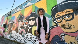 "Mississippi native and musician Keyone Starr stands beside a mural Friday on Millsaps Avenue. She sang on the Grammy-nominated album ""Uptown Special"" and sang the song ""I Can't Lose."" She is the reason why ""Jackson, MS"" is mentioned on ""Uptown Funk,"" which is also on ""Uptown Special."""