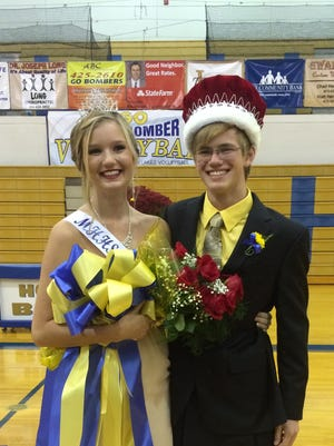 2014 Mountain Home High School homecoming queen Summer Webers and king Jimmy McDaniel are shown after being crowned Friday night in The Hangar. Rainy weather moved the coronation ceremony inside MHHS gym.