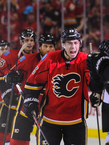 Johnny Gaudreau #13 of the Calgary Flames scores against