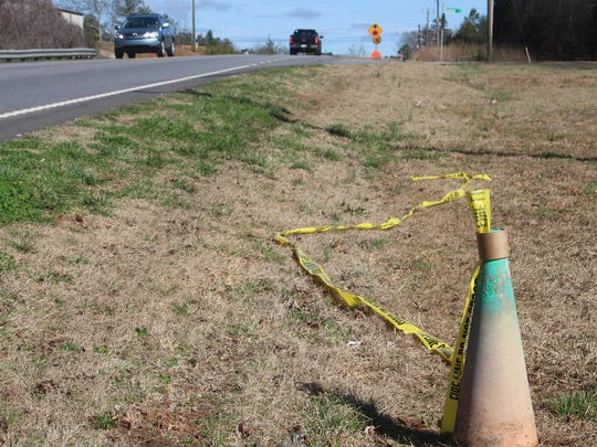 Yellow fire department tape lies next to Wells Highway near Seneca where 11-year-old Emmalee Budrevich died Saturday night in a hit-and-run collision.