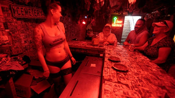 Bartender Sara Stenberg talks with patrons in the Dungeon