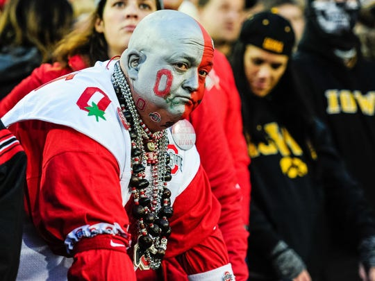 Nov 4, 2017; Iowa City, IA, USA; Ohio State Buckeye fans react during the fourth quarter against the Iowa Hawkeyes at Kinnick Stadium. Iowa won 55-24. Mandatory Credit: Jeffrey Becker-USA TODAY Sports