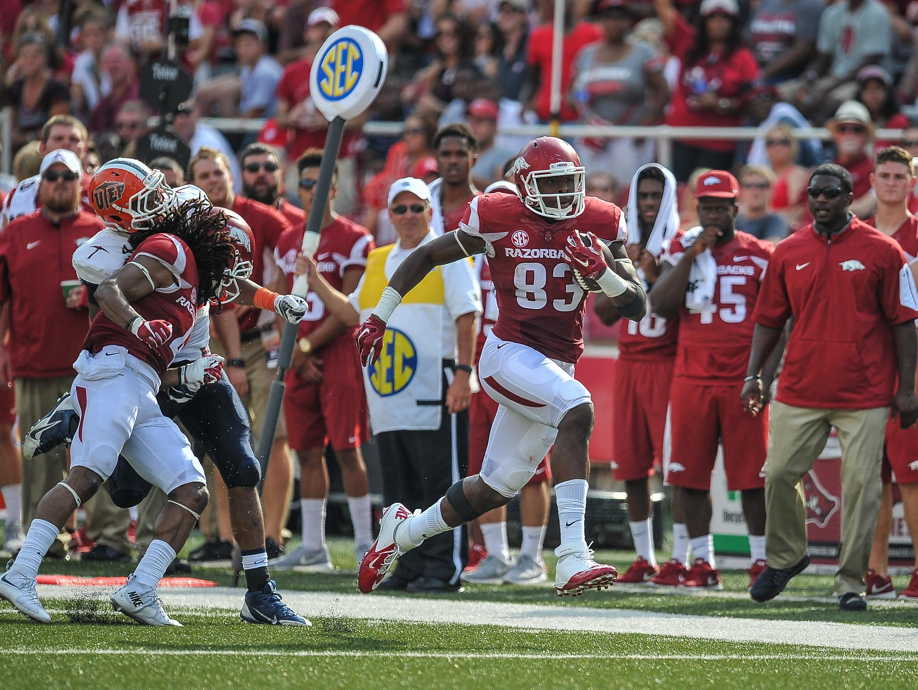 Arkansas tight end Jeremy Sprinkle (83) takes off on a 42-yard reception during action in the Razorbacks' 48-13 season-opening win over UTEP. Sprinkle had his best career game in Week 1, catching two passes for 60 yards.