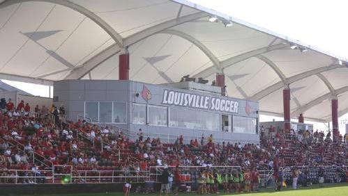 Fans look on during a Louisville women's soccer game on Aug. 28, 2014.