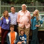 """Christina Applegate, standing from left, Ed Helms, Chevy Chase, Beverly D'Angelo, Skyler Gisondo, kneeling left, and Steele Stebbins appear in a scene from """"Vacation."""""""