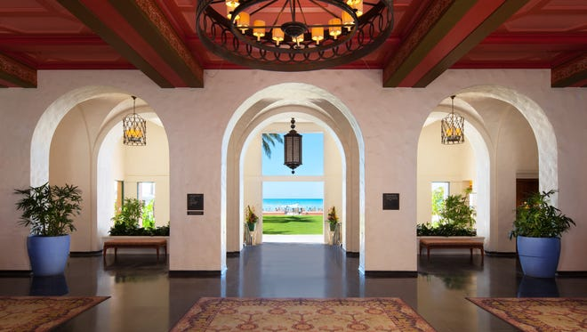 The open-air Lower Lobby of The Royal Hawaiian opens up to the Pacific Ocean.