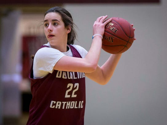 Caitlin Clark looks to pass the ball during practice