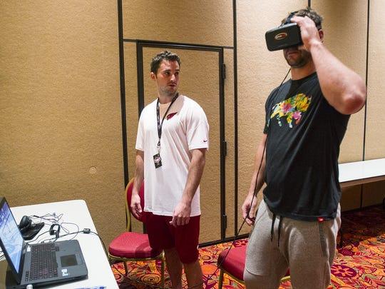 Arizona Cardinals quarterback Drew Stanton tests the new virtual reality system to train quarterbacks with Colin Clancy (left) last year.