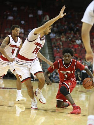 Louisville's Darius Perry took a knee while dribbling the ball against Anas Mahmoud during the first half of the team's first scrimmage of the year. Oct. 13, 2017.