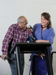Claire Capra monitors a pulmonary rehabilitation patient