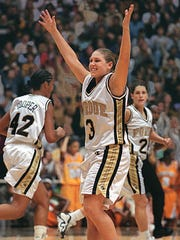 Purdue's Kelly Komara signals a 3-pointer after Stephanie White, right, drilled the shot late in an upset of No. 1 Tennessee on Nov. 15, 1998. White and Komara now coach at Vanderbilt.