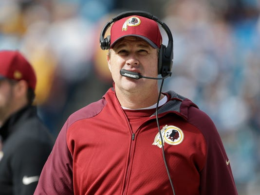 FILE - In this Sunday, Nov. 22, 2015 file photo, Washington Redskins head coach Jay Gruden watches the action in the first half of an NFL football game against the Carolina Panthers in Charlotte, N.C. The Redskins  have the 21st pick in the first round in next week's NFL draft in Chicago.  (AP Photo/Bob Leverone, File)
