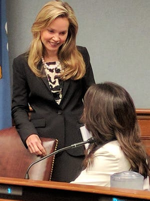 Rep. Helena Moreno, D-New Orleans, confers with Rep. Dodie Horton, R-Haughton, before introducing House Bill 222 that would prohibit employers from retaliating against employees for discussing wage information.