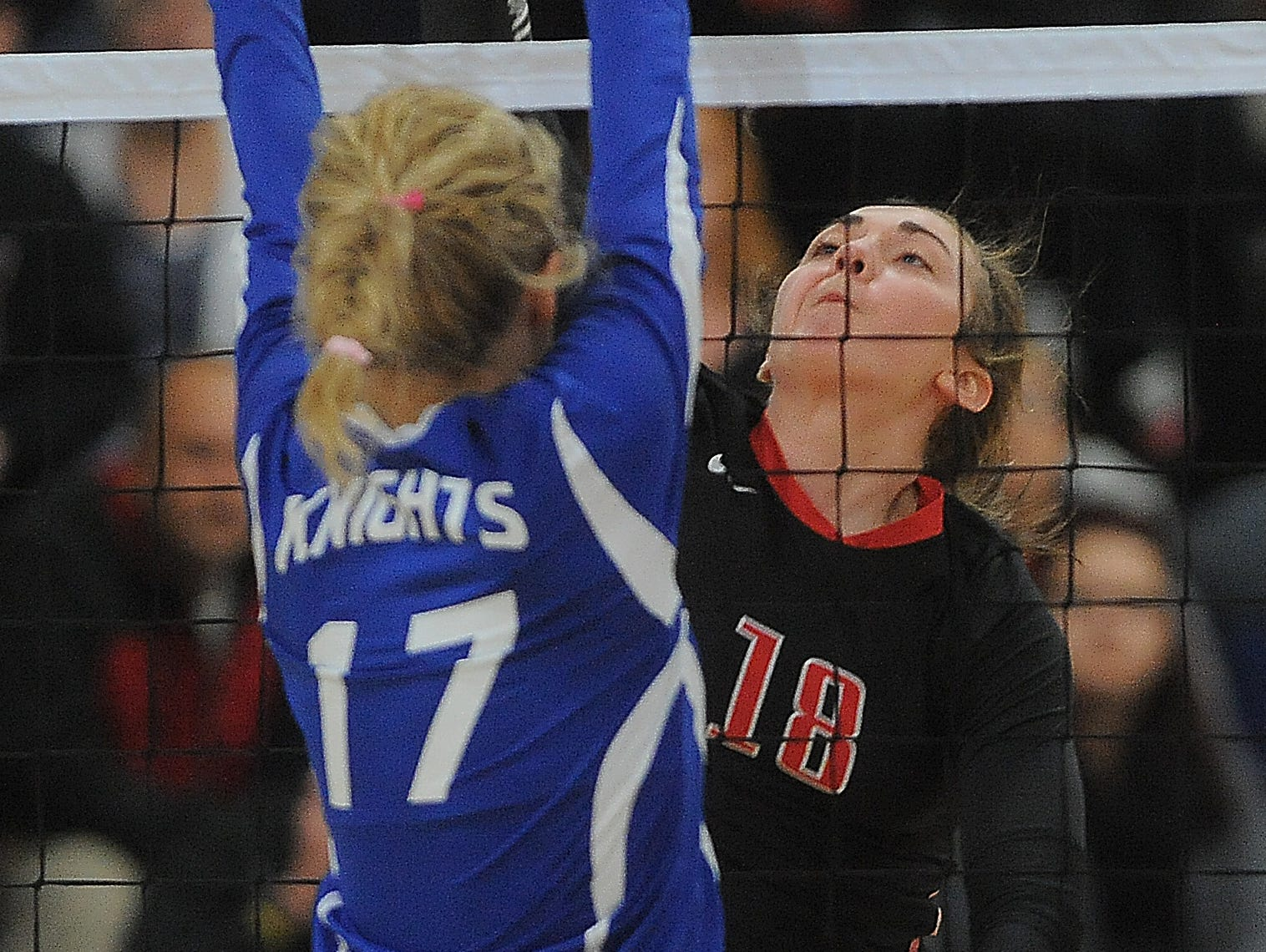 Brandon Valley's Elsie Zajicek spikes the ball while O'Gorman's Rylee Smith goes up to block during their game at O'Gorman High School.