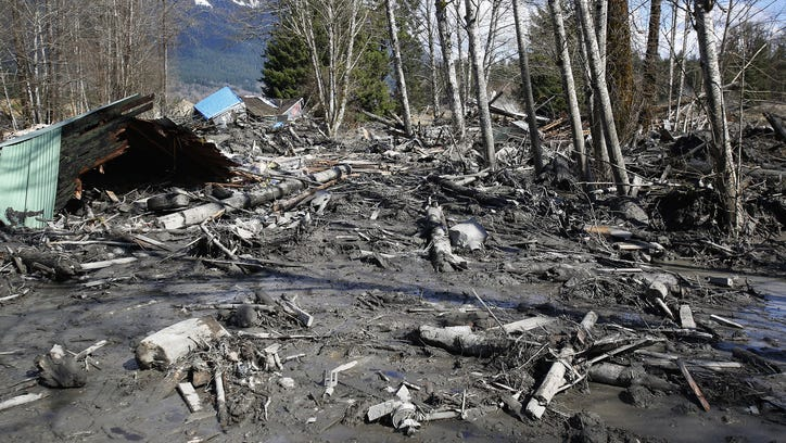 A house sits destroyed in the mud on Highway 530 near Arlington, Washington.