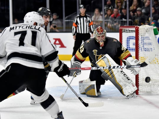 Los Angeles Kings center Torrey Mitchell (71) shoots against Vegas Golden Knights goalie Maxime Lagace during the first period of an NHL hockey game Tuesday, Feb. 27, 2018, in Las Vegas. (AP Photo/David Becker)