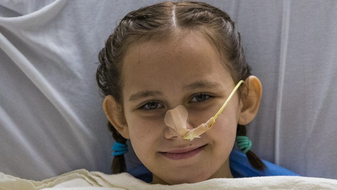 Eight-year-old Isabella McCune recovers at the Arizona Burn Center of the  Maricopa Integrated Health System in Phoenix.
