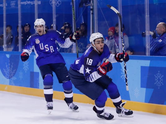 FILE - In this Feb. 14, 2018, file photo, Jordan Greenway (18), of the United States, celebrates with teammate Bobby Sanguinetti (22) after scoring a goal during the second period of the preliminary round of the men's hockey game against Slovenia at the 2018 Winter Olympics in Gangneung, South Korea. The Minnesota Wild have signed left wing Jordan Greenway to a three-year, entry-level contract, adding one of the organization's top prospects for the stretch run of the playoff race. The Wild announced the addition Monday, March 26, 2018, the day after Greenway and Boston University lost in the regional finals of the NCAA Tournament. (AP Photo/Frank Franklin II, File)