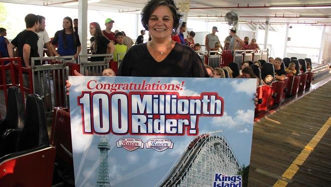 Angela Marshall, Chattanooga, Tenn., took the 100 millionth ride ton Kings Island's Racer twin-track roller coaster.