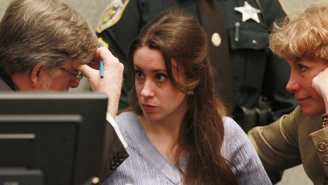 Casey Anthony looks at her attorney, Cheney Mason, before the start of her sentencing hearing on charges of lying to a law enforcement officer at the Orange County Courthouse July 7, 2011 in Orlando, Fla.  Anthony was acquitted of murder charges on July 5, 2011.