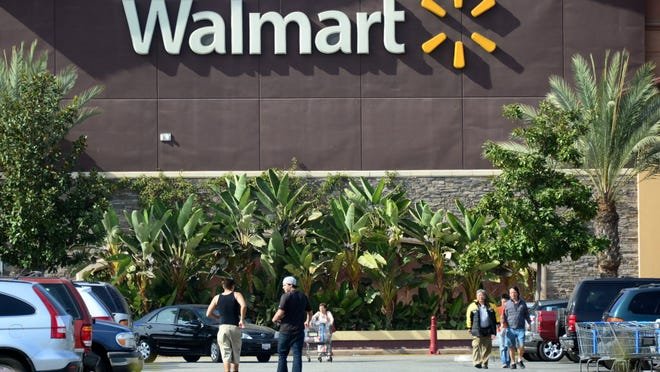 (FILES) This January 29, 2014 file photo shows shoppers  outside a Walmart store in Rosemead, California. US retail king Wal-Mart toppled Royal Dutch Shell from the top spot on the Fortune Global 500 list of the world's biggest companies, based on total revenues, the magazine said July 7, 2014. Wal-Mart Stores reported $476.3 billion in revenues for 2013 as it ramped up international business. AFP PHOTO FREDERIC J. BROWNFREDERIC J. BROWN/AFP/Getty Images ORIG FILE ID: 531434764