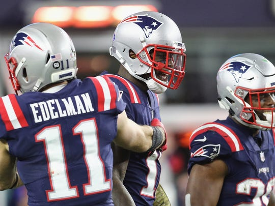 FOXBOROUGH, MA - NOVEMBER 04:  Josh Gordon #10 of the New England Patriots celebrates with Julian Edelman #11 after scoring a 55-yard receiving touchdown during the fourth quarter against the Green Bay Packers at Gillette Stadium on November 4, 2018 in Foxborough, Massachusetts.  (Photo by Maddie Meyer/Getty Images)