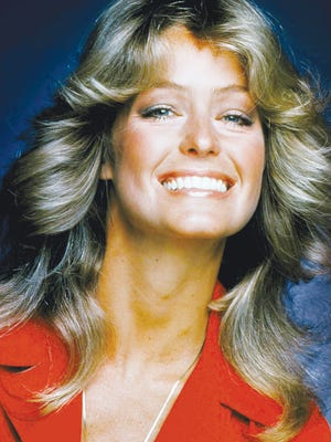 """In this 1977 file photo originally released by ABC, Farrah Fawcett-Majors, from the series """"Charlie's Angels,"""" is shown. Fawcett died Thursday, June 25, 2009 in a Los Angeles hospital. She was 62."""
