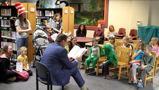 """Sen. Mark Green reads Dr. Seuss's """"Bartholomew and the Oobleck"""" to kids at the Clarksville-Montgomery County Public Library in March 2016 as part of the annual Read Across America program."""