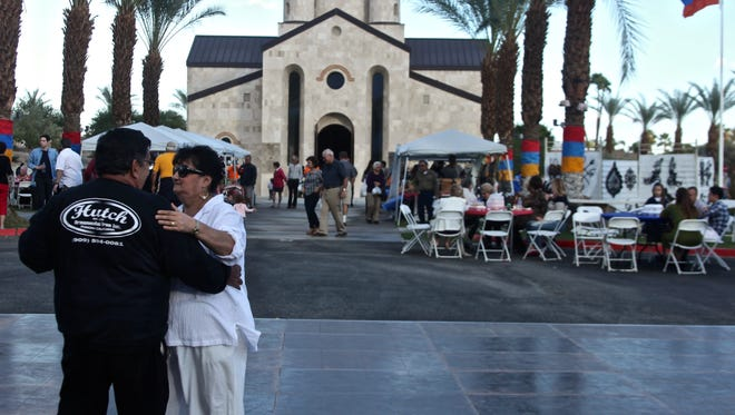 A couple dances outside Rancho Mirage's St. Garabed Armenian Apostolic Church of the Desert during the 8th Annual Armenian Cultural Festival on Sunday.