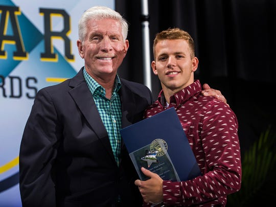 Lake Forest's Benjamin Moore poses with Mike Schmidt after being named the inspirational player of the year at the Delaware Sports Awards banquet at the Bob Carpenter Center at the University of Delaware in Newark on Wednesday evening.