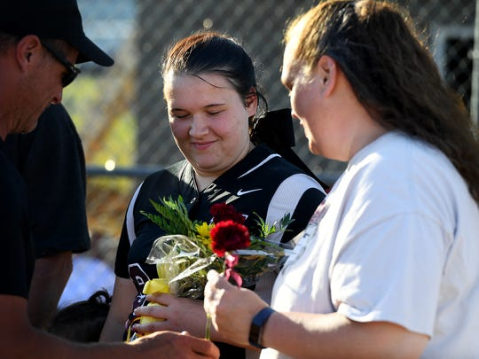 West Carroll High School senior Ashley Barlow receives flowers from her coach during the teams' senior night recognition, Monday, April 30.