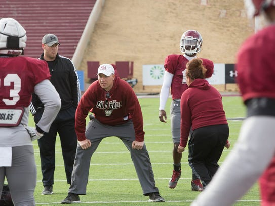 Former New Mexico State quarterback and second-year assistant coach Chase Holbrook will be the Aggies  quarterbacks position coach in 2018.