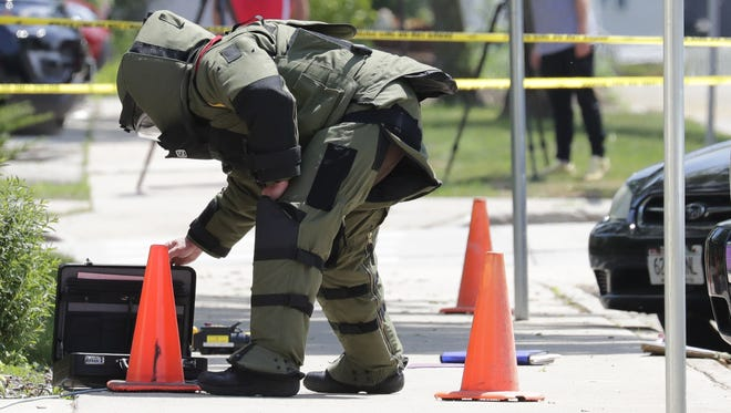 Srgt. John Schuette, of the Outagamie County Sheriff's Department, wears a bomb squad suit while securing a suspicious package found in front of the Outagamie County administrative building along South Walnut Street Tuesday.