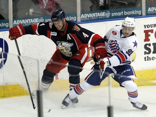 Rochester's Frederick Roy, right, battles with Grand