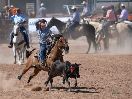 Bonner Voss tries to rope the head of a calf during team roping Friday at the Wild Horse Prairie Days rodeo. The team roping competition was renamed this year in honor of Gideon Carmichael who died in 2017. The festival continued at the Haskell Expo Center Saturday.