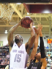 McMurry's LaRandall Scroggins goes up for a layup while