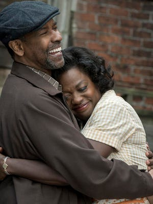 """This image released by Paramount Pictures shows Denzel Washington, left, and Viola Davis in a scene from """"Fences."""""""