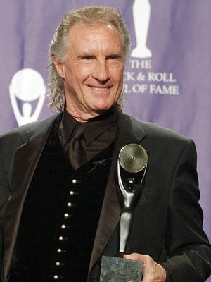 FILE - in this March 10, 2003 file photo, Bill Medley, one half of the famed Righteous Brothers signing duo, poses for photographers after being inducted into the Rock and Roll Hall of Fame in New York City. Los Angeles County authorities said Friday, Jan. 27, 2017, they've solved the 1976 rape and killing of Medley's ex-wife, Karen Klaas. Investigators said they've identified a suspect by using DNA from a relative of the suspect.